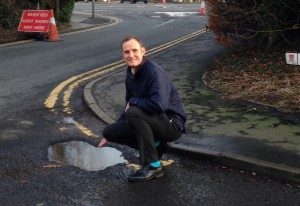 Simon Thomson viewing the pot hole at the entrance to The Brambles.